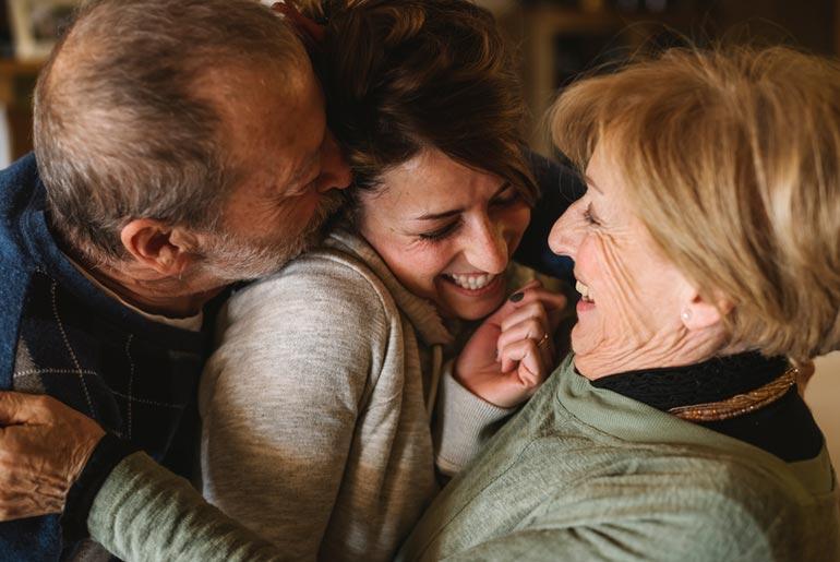 family hug after laser dentistry treatment